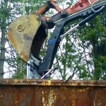 dumpster loading with excavator thumb