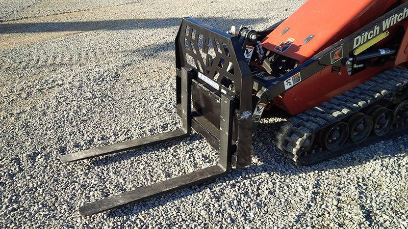 Ditch Witch mini skid steer with mini pallet forks